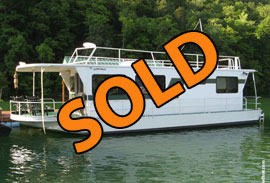 1984 SkipperLiner 14 x 50 Steel Hull Houseboat with Dock and Pontoon Boat For Sale on Norris Lake TN