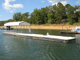 10.5 x 65 Concrete Dock with 24 foot covered patio and shore power cable for sale on Norris Lake TN at Cedar Grove Marina